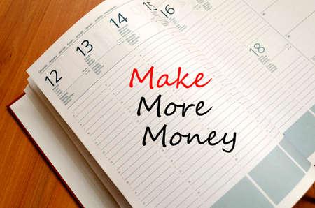 Make More Money Concept Notepad photo
