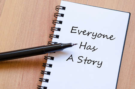 Everyone has a story concept Notepad Stock Photo