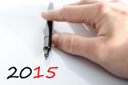 outlook: Pen in the hand isolated over white background 2015 concept
