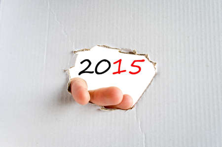 outlook: Hand on the cardboard background 2015 concept