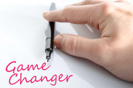 Pen in the hand isolated over white background game changer concept