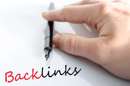 linkbuilding: Pen in the hand isolated over white background backlinks concept
