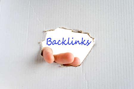 linkbuilding: Hand on the cardboard background backlinks concept