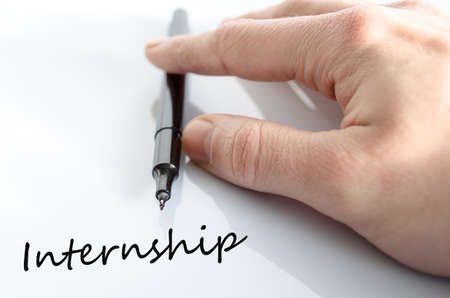 internship: Pen in the hand isolated over white background internship concept