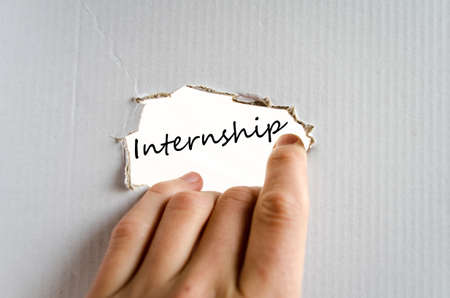 internship: Hand on the cardboard background internship concept Stock Photo