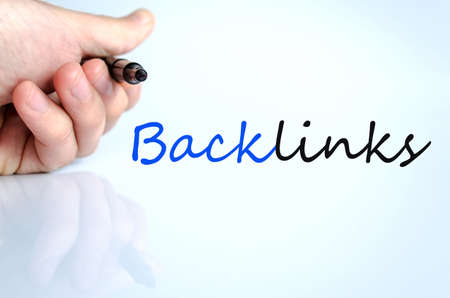 backlinks: Pen in the hand isolated over white background backlinks concept