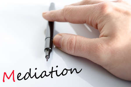 Pen in the hand isolated over white background mediation concept