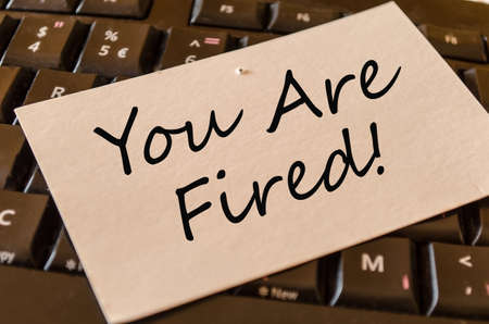 you are fired: You are fired Concept on black keyboard note Stock Photo