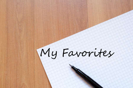 favorites: White blank notepad on office wooden table My favorites concept