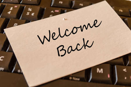 Welcome back note from colleagues at work Stockfoto