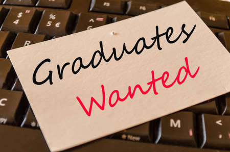 Graduates wanted Concept on black keyboard