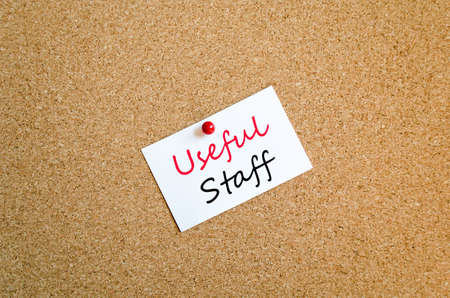 Sticky Note On Cork Board Background Useful Staff concept Stock Photo