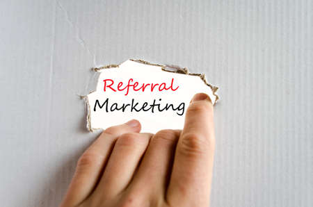 referral marketing: Hand and text on the cardboard background Referral Marketing concept Stock Photo