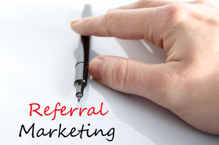 referral marketing: Pen in the hand isolated over white background Referral Marketing Concept