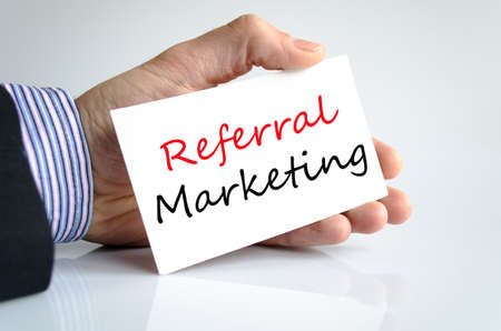 referral marketing: Referral Marketing concept note in business man hand
