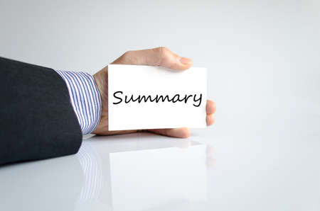 summary: Business man hand writing Summary Stock Photo