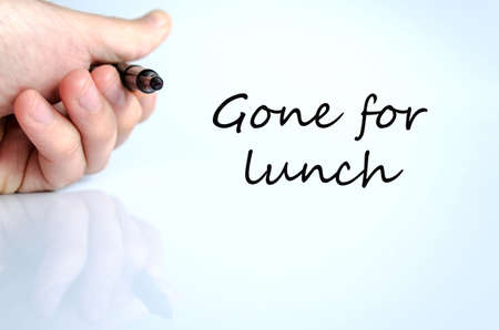 unoccupied: Pen in the hand isolated over white background Gone for lunch concept