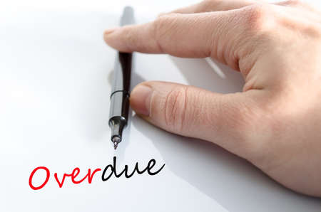 overdue: Pen in the hand isolated over white background Overdue concept Stock Photo