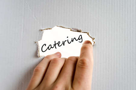 cuisine entertainment: Hand and text on the cardboard background Catering