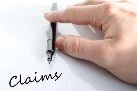 Pen in the hand isolated over white background Claims Concept Stock Photo