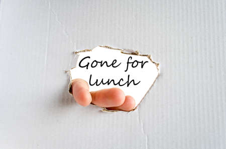 gone: Hand and text on the cardboard background Gone for lunch concept Stock Photo