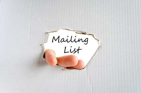 mailing: Hand and text on the cardboard background Mailing list concept