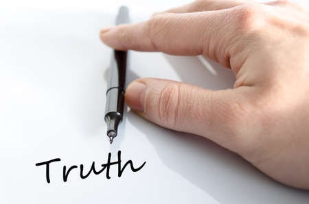 untrue: Pen in the hand isolated over white background Truth concept