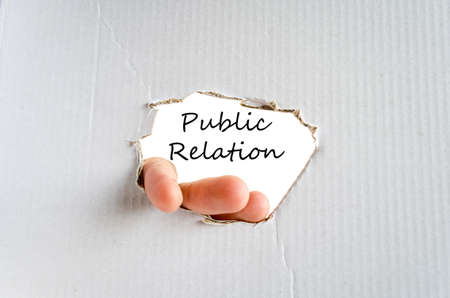 public relation: Hand and text on the cardboard background Public relation