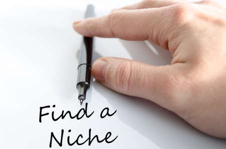 Pen in the hand isolated over white background Find a Niche Concept