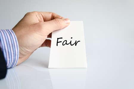 unjust: Business man hand writing Fair