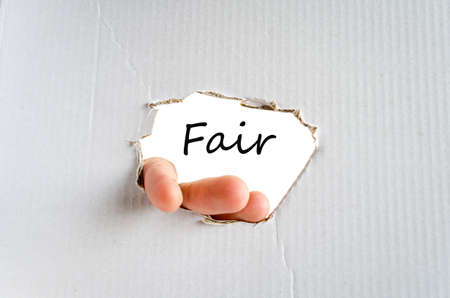 unbiased: Hand and text on the cardboard background Fair Stock Photo