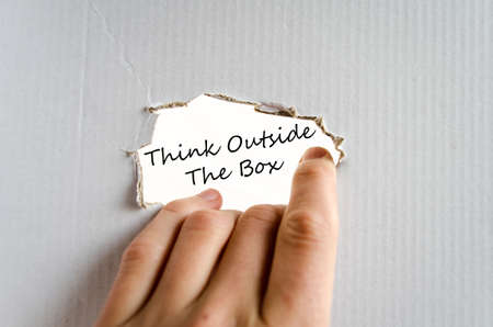 receptive: Hand and text on the cardboard background Think outside the box