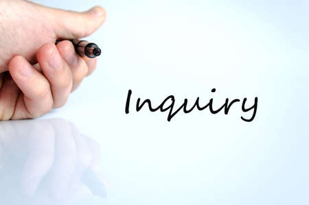 inquiry: Pen in the hand isolated over white background Inquiry concept Stock Photo