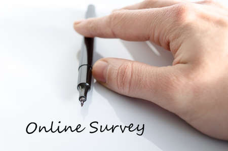 appraise: Pen in the hand isolated over white background Online Survey concept