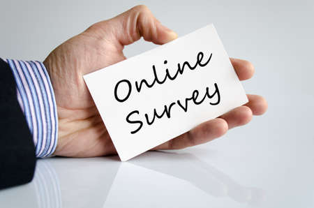 electronic voting: Business man hand writing online survey