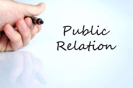 public relation: Pen in the hand isolated over white background public relation Stock Photo