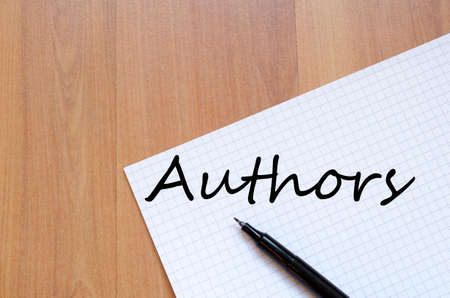 phrase novel: White blank notepad on office wooden table Authors concept