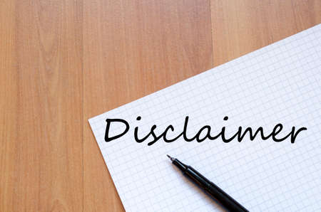 White blank notepad on office wooden table Disclaimer concept Stock Photo