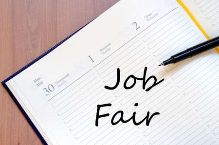 yellow notepad: Yellow blank notepad on office wooden table Job Fair concept