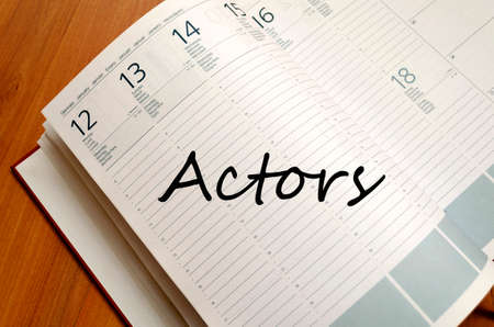 actors: Business Notepad on wooden table Actors concept
