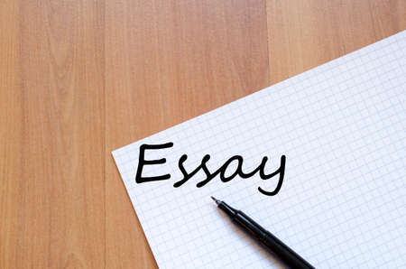 essay: White blank notepad on office wooden table Essay concept Stock Photo