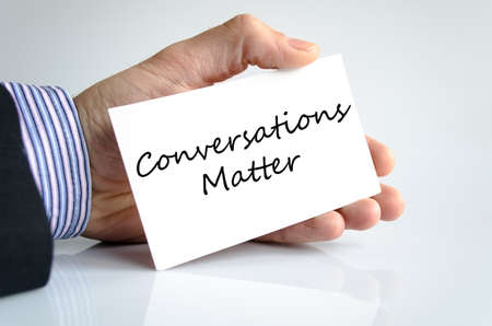 Conversations matter text note in business man hand