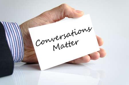 business matter: Conversations matter text note in business man hand