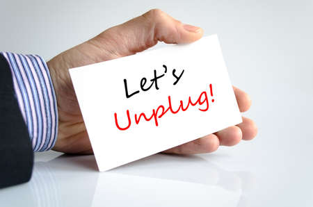 unplug: Lets unplug text concept isolated over white background Stock Photo