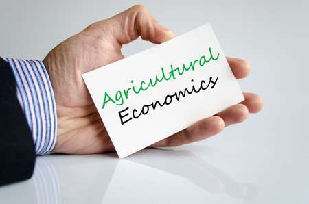 Agricultural economics text concept isolated over white background
