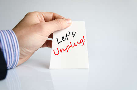 socialising: Lets unplug text concept isolated over white background Stock Photo