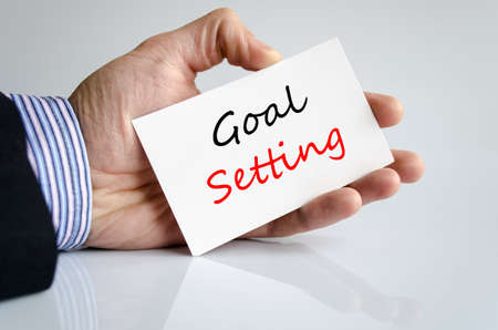 setting goal: Goal setting text concept isolated over white background