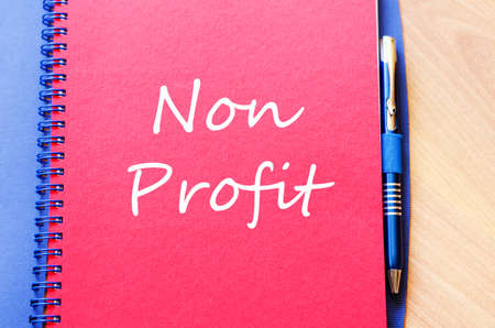 non: Red notepad and Non profit text concept
