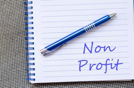 non: Blue notepad and Non profit text concept Stock Photo