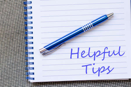 helpful: Blue notepad and Helpful tips text concept Stock Photo